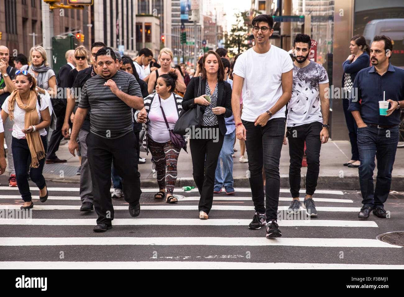 NEW YORK CITY - SEPTEMBER 14, 2015: Pictured here is a crosswalk in midtown Manhattan with a diversity of pedestrians - Stock Image
