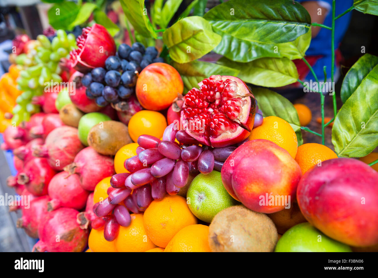 Many kind of different fruits on a showcase - Stock Image