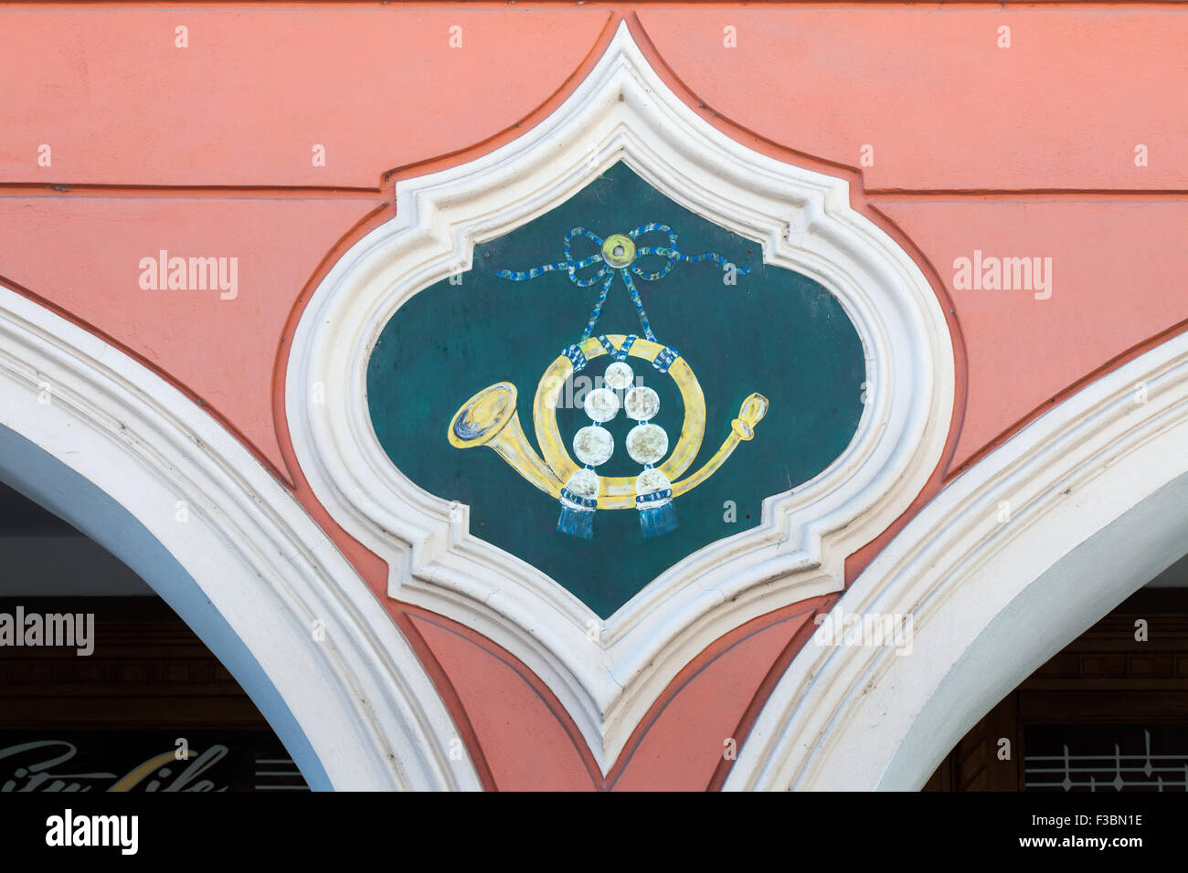 Post horn depicted on the medieval house sign at Premysl Otakar II Square in Ceske Budejovice, South Bohemia, Czech - Stock Image