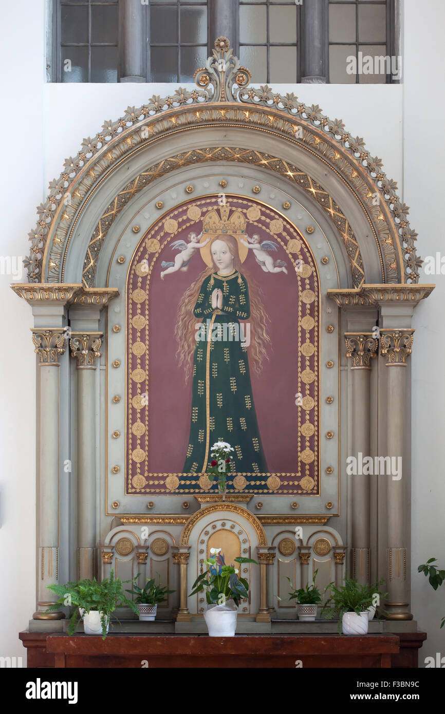 Virgin Mary of Budejovice also known as the Virgin Mary with the Wheat Ears depicted in the side altar of the Church - Stock Image
