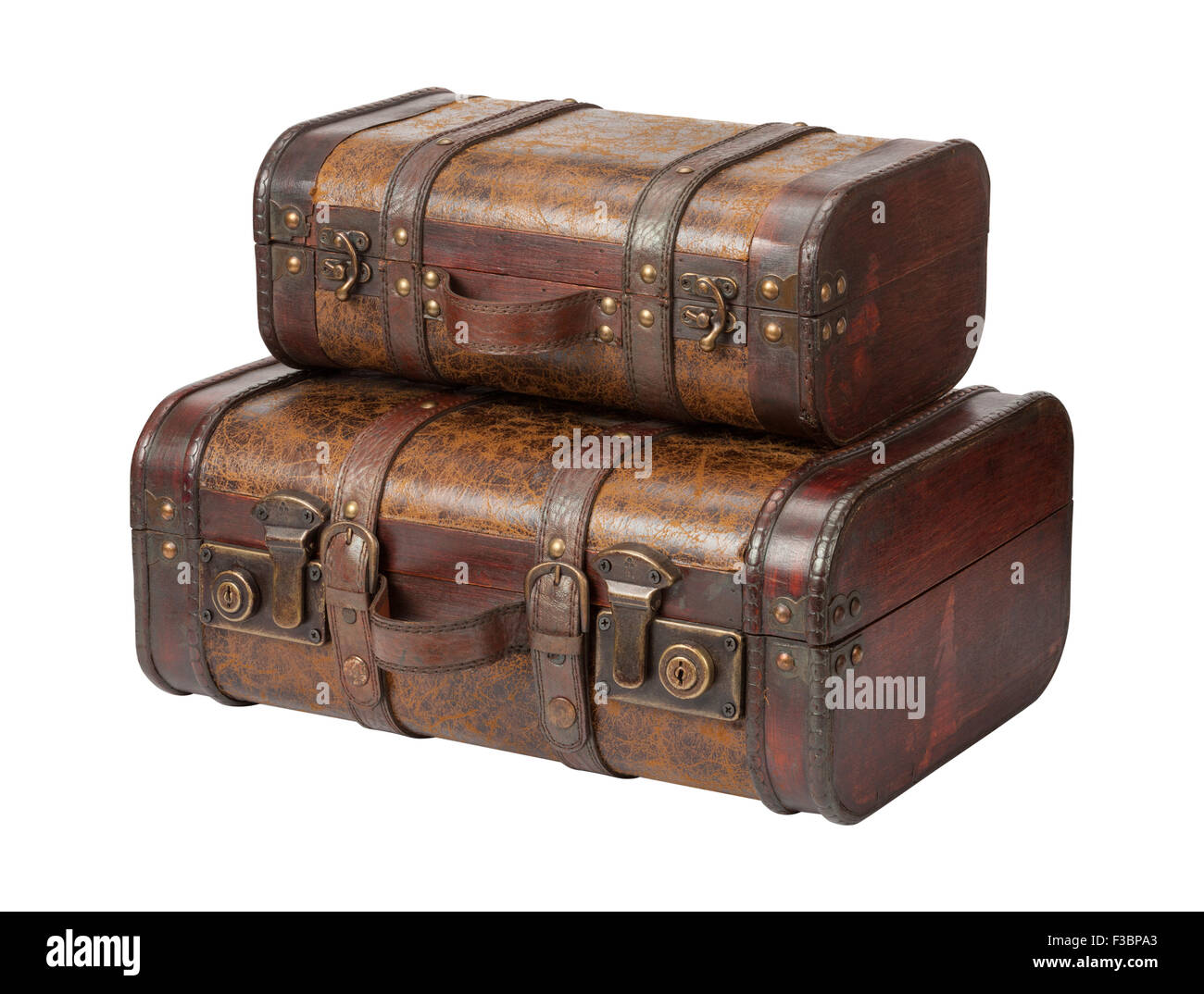 Two Antique Leather Suitcases Stacked. The image is a cut out, isolated on a white background. - Stock Image
