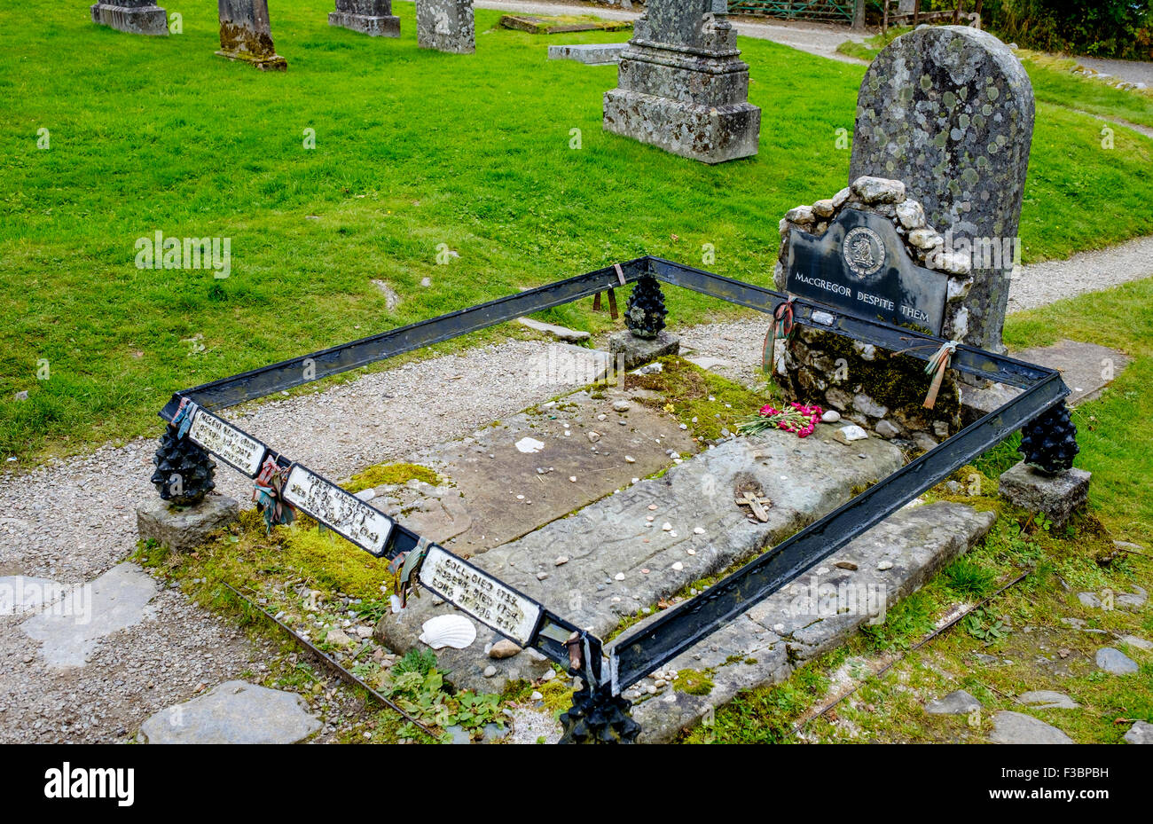 Tomb of Rob Roy McGregor, his wife and son in Balquhidder Kirk Graveyard in the Trossachs, Scotland Stock Photo