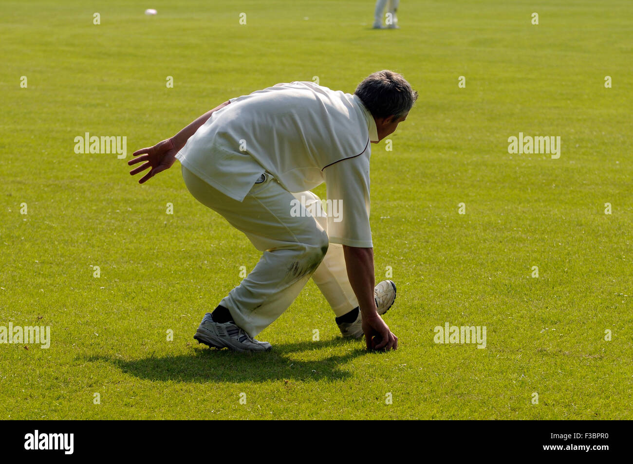 Cricket match in Rye East Sussex England UK Europe, sport white batsman british game people ball - Stock Image