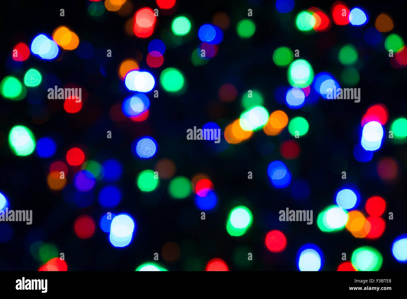 Abstract blurred effect Illuminated closeup of tangled Christmas lights - Stock Image
