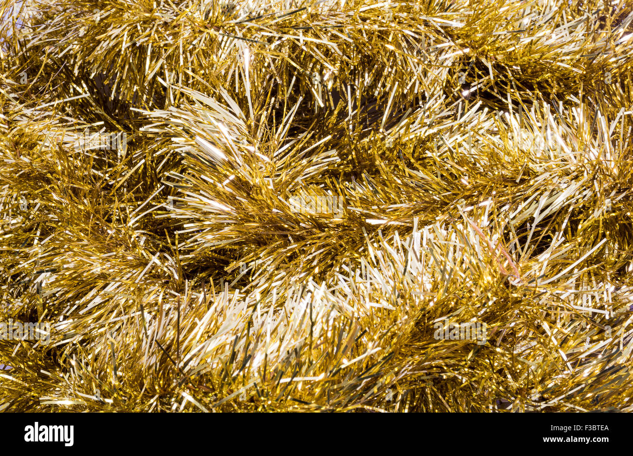 Gold Tinsel background - Stock Image