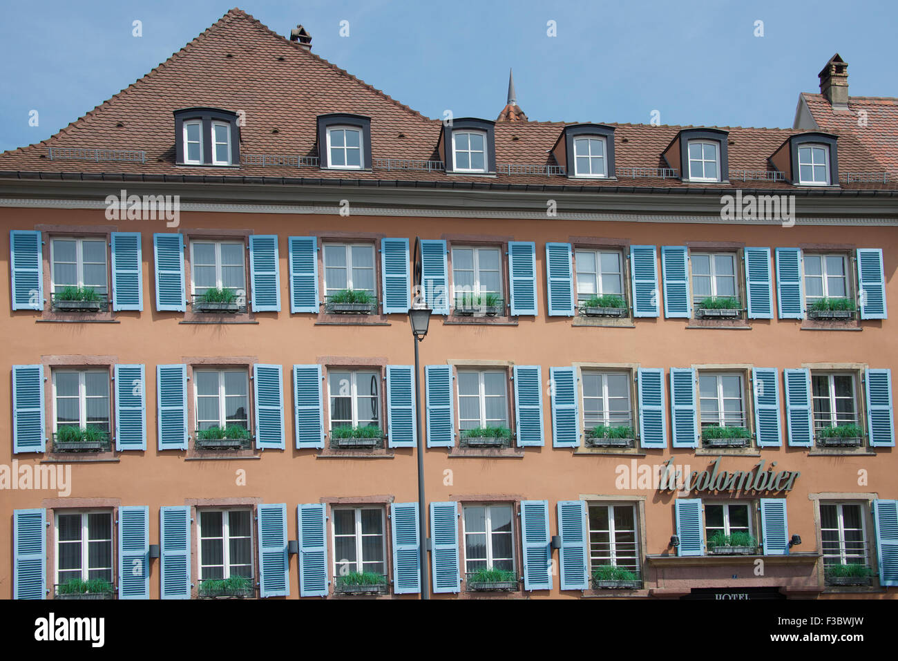Hotel with traditional blue shuttered windows Petit Venise Colmar Alsace France - Stock Image