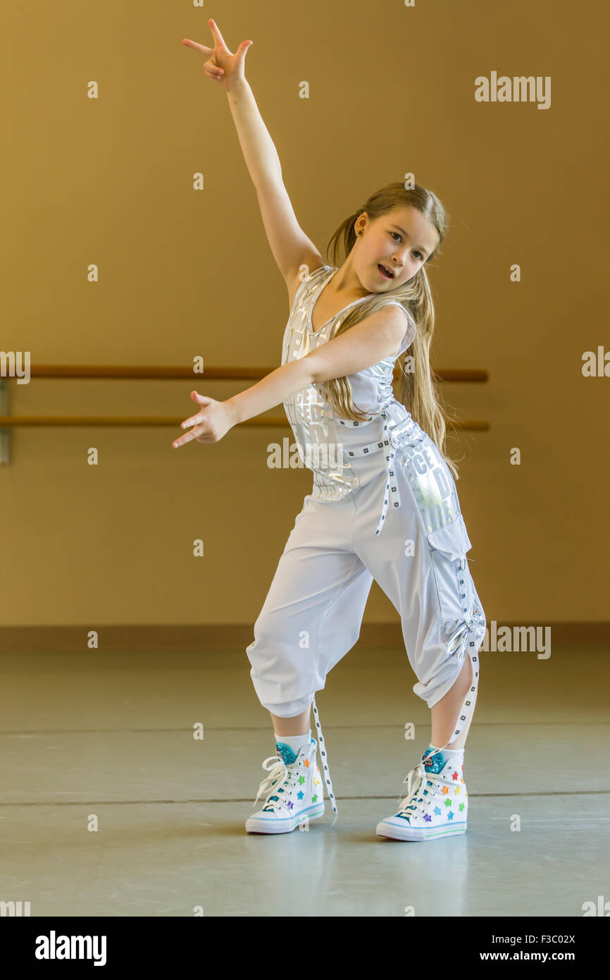 Eight Year Old Girl Doing A Hip Hop Dance In A Dance Studio In Stock Photo Alamy