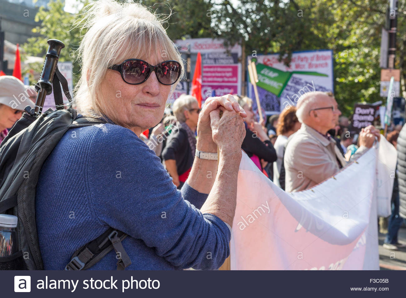Manchester, UK. 4th October, 2015. Anti austerity rally in Manchester, UK. Meg McDonald, 73, from London, member - Stock Image