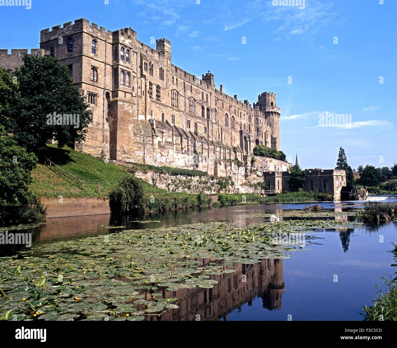 View of the Medieval castle alongside the River Avon, Warwick, Warwickshire, England, UK, Western Europe. - Stock Image