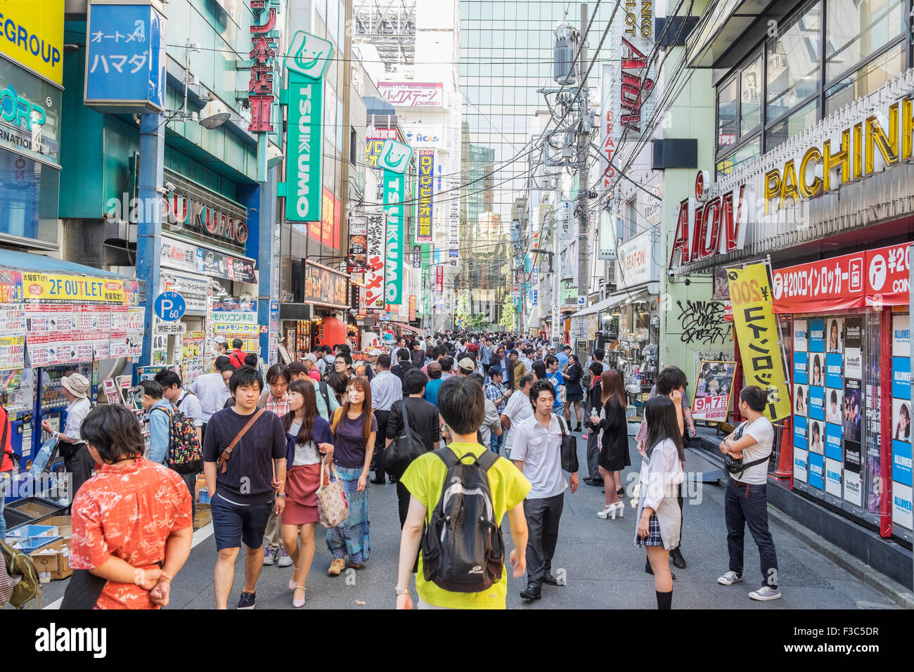 Busy street in Akihabara known as Electric Town or Geek Town selling Manga based games and videos in Tokyo Japan - Stock Image