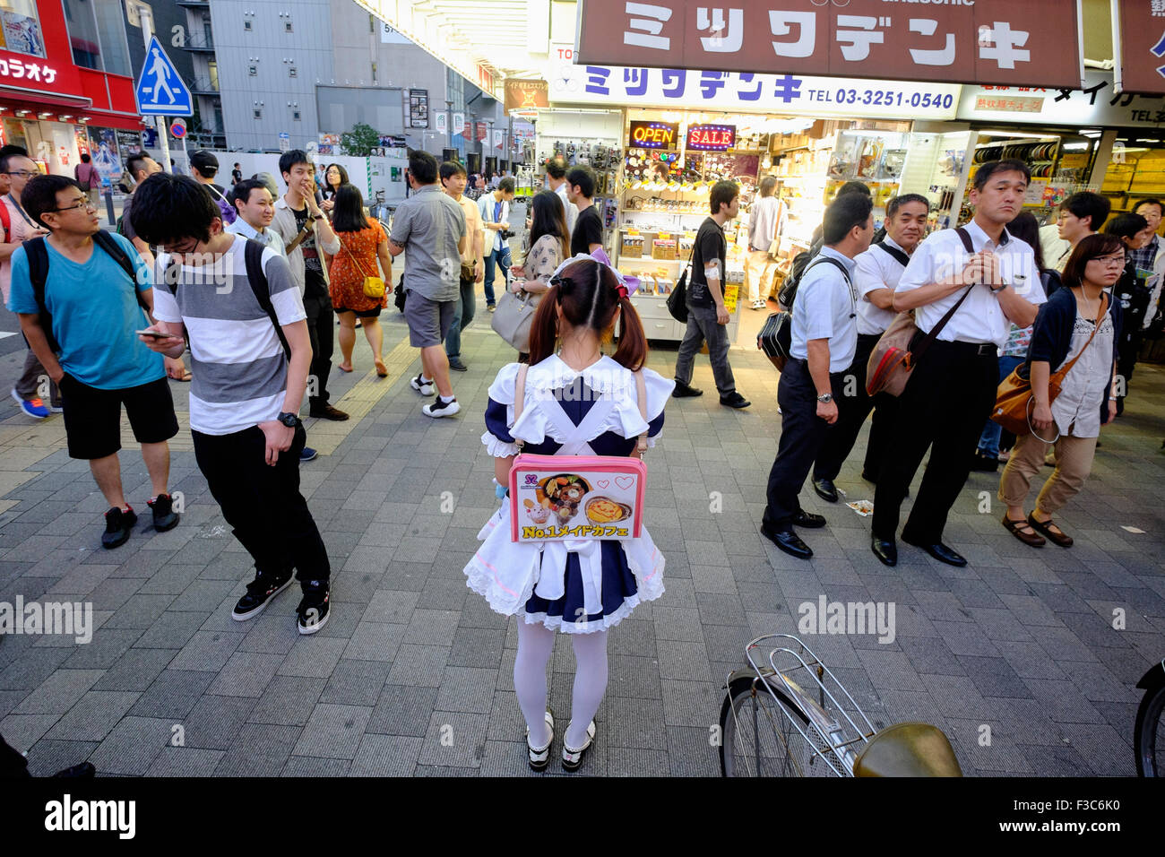 Young woman advertising Maids' Cafe in Akihabara known as Electric Town or Geek Town selling Manga based games - Stock Image