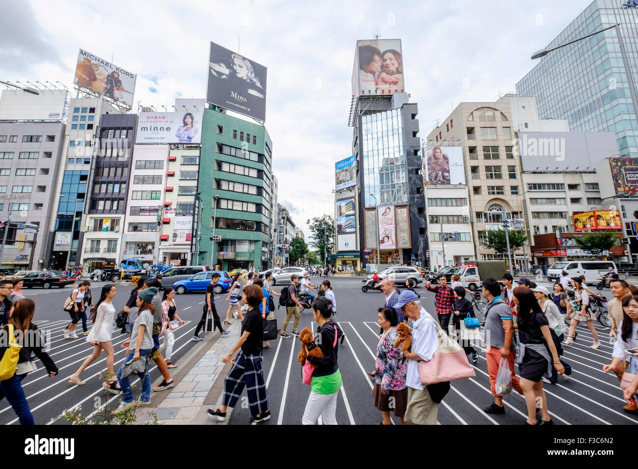 Busy pedestrian crossing at fashionable Omotesando district in Tokyo Japan - Stock Image