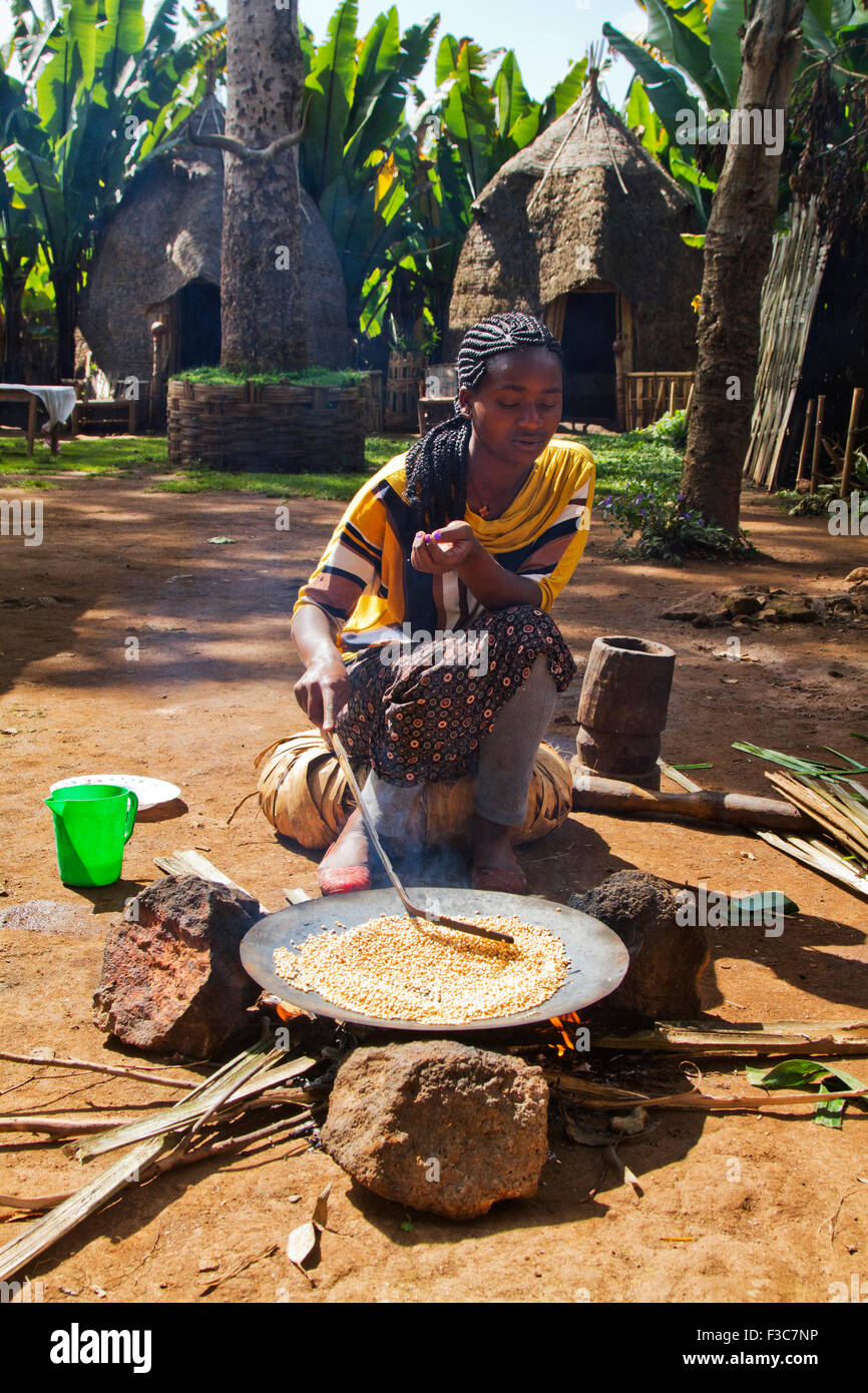 Dorse woman roasts coffee beans. Photographed in the Omo Valley, Ethiopia Stock Photo
