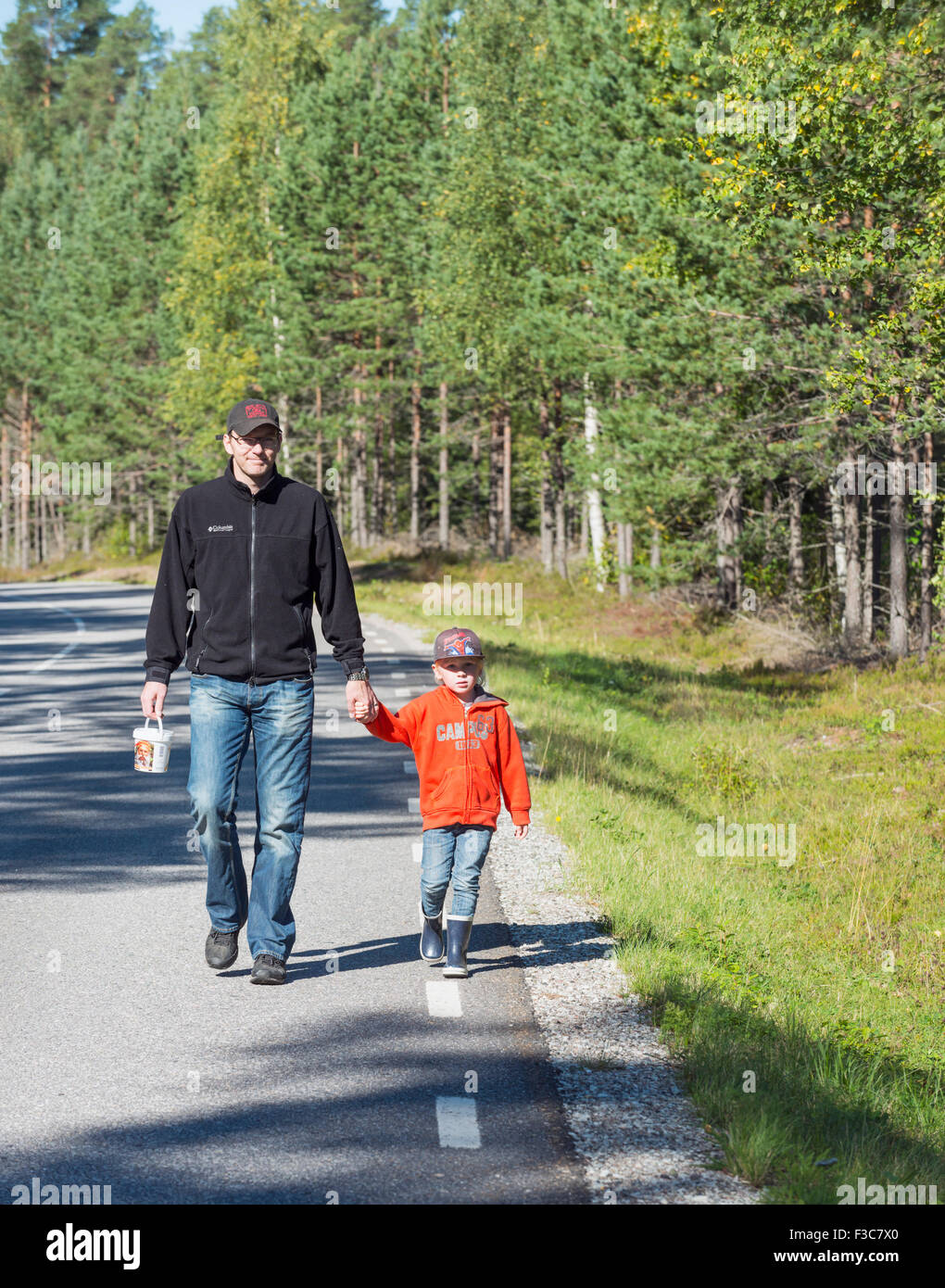 Daddy and child taking a walk - Stock Image