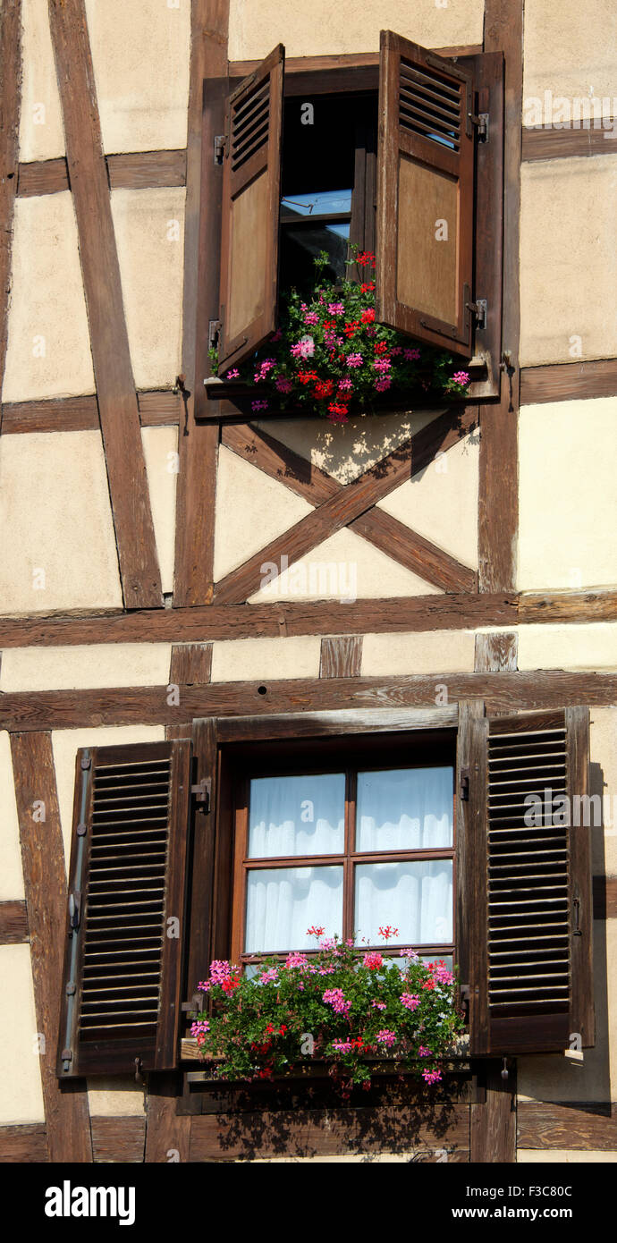Two traditional shuttered windows half timbered house Petite Venise Colmar Alsace France - Stock Image