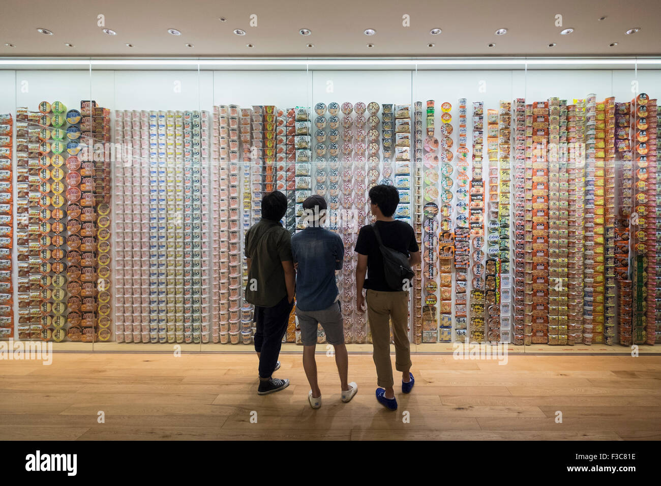 Interior display of historic cup noodle brands and packaging at Cup Noodle Museum in Minato Mirai district of Yokohama - Stock Image