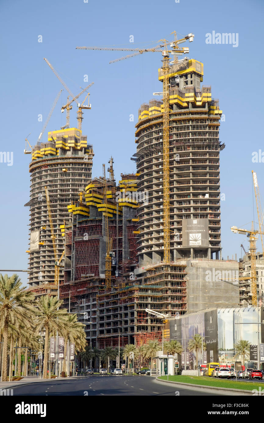 Three high-rise apartment towers under construction in Downtown Dubai district in United Arab Emirates Stock Photo