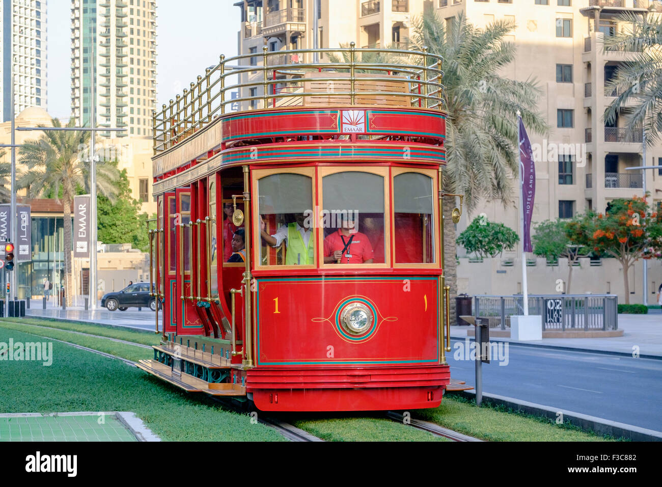 New Dubai Trolley (San Francisco style hydrogen fuel cell powered tram) travelling along street in Dubai United - Stock Image
