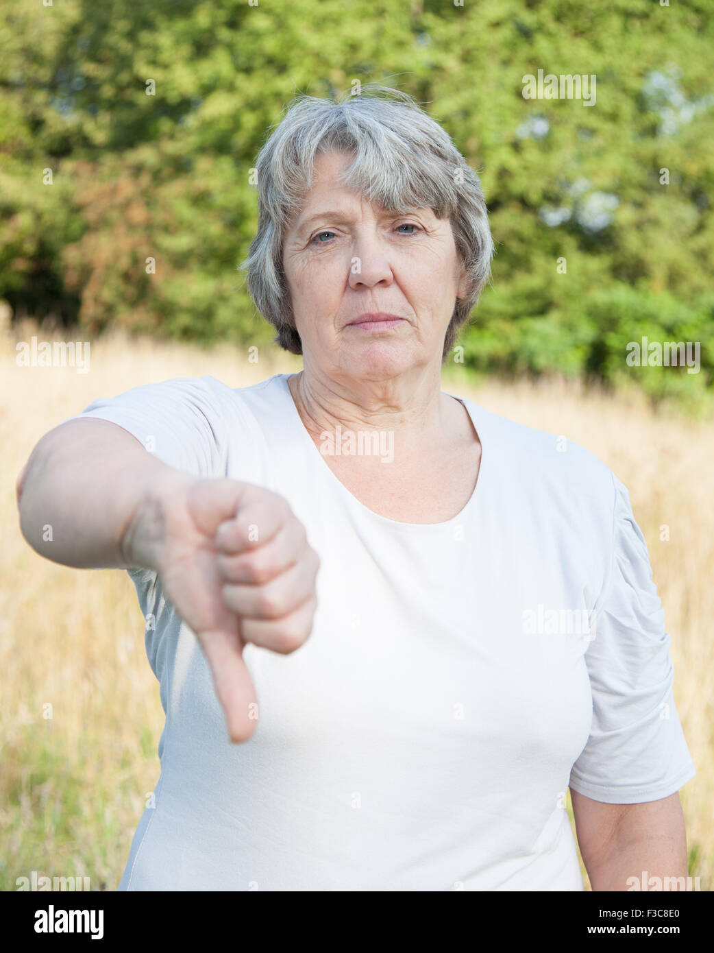 Old age woman showing thumbs down - Stock Image