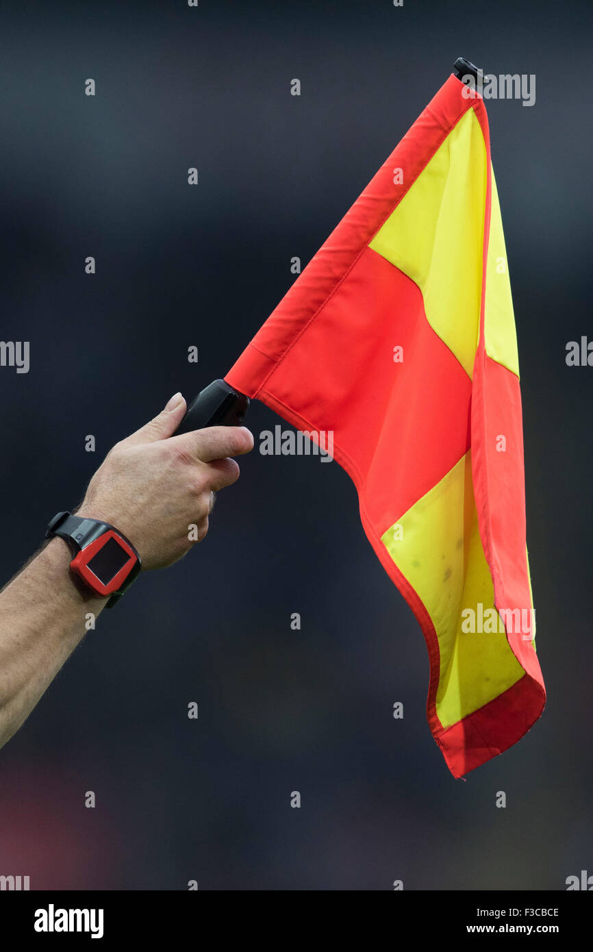 A linesman's flag held by an assistant referee at a football match. - Stock Image
