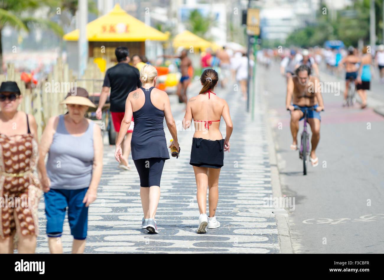RIO DE JANEIRO, BRAZIL - FEBRUARY 20, 2013: Active residents take to the beachfront boardwalk for recreation on - Stock Image