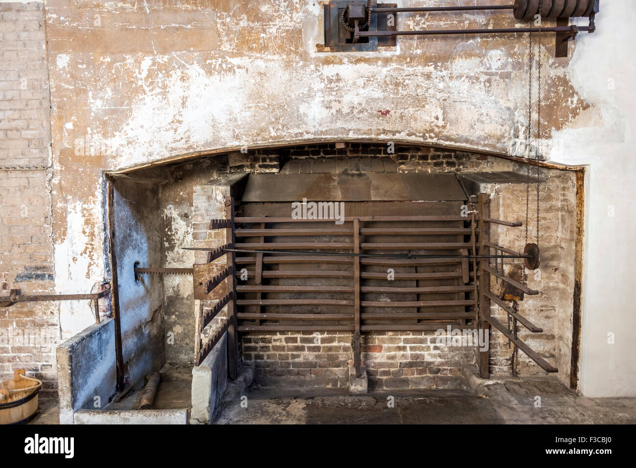 Fire place for roasting meat in the Royal Kitchens, Kew Gardens, London, UK - Stock Image