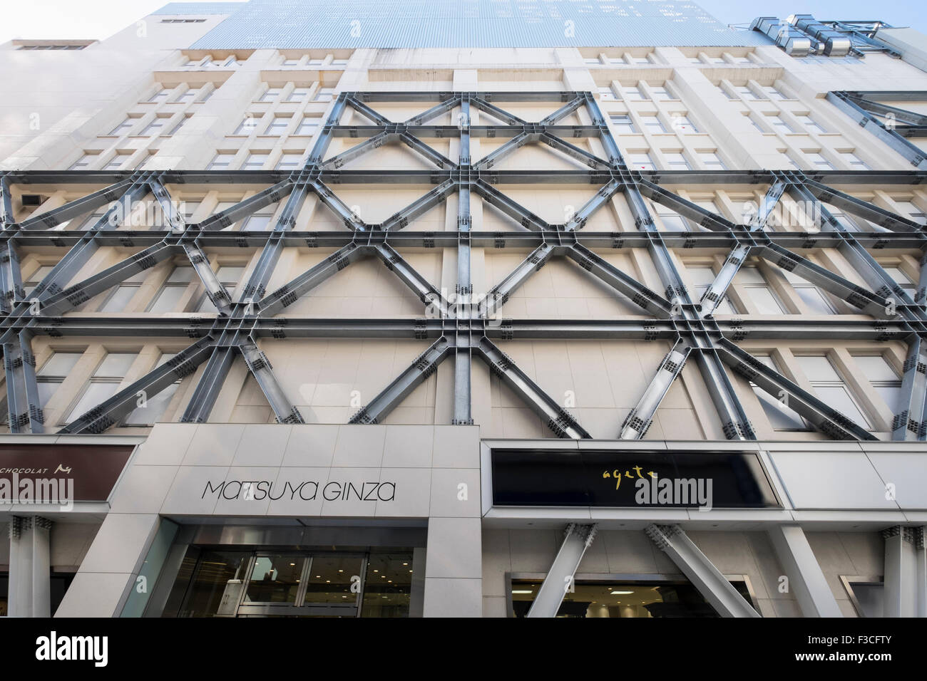 Structural steel bracing to strengthen building against earthquakes retro fitted to Matsuya Department Store, Ginza - Stock Image
