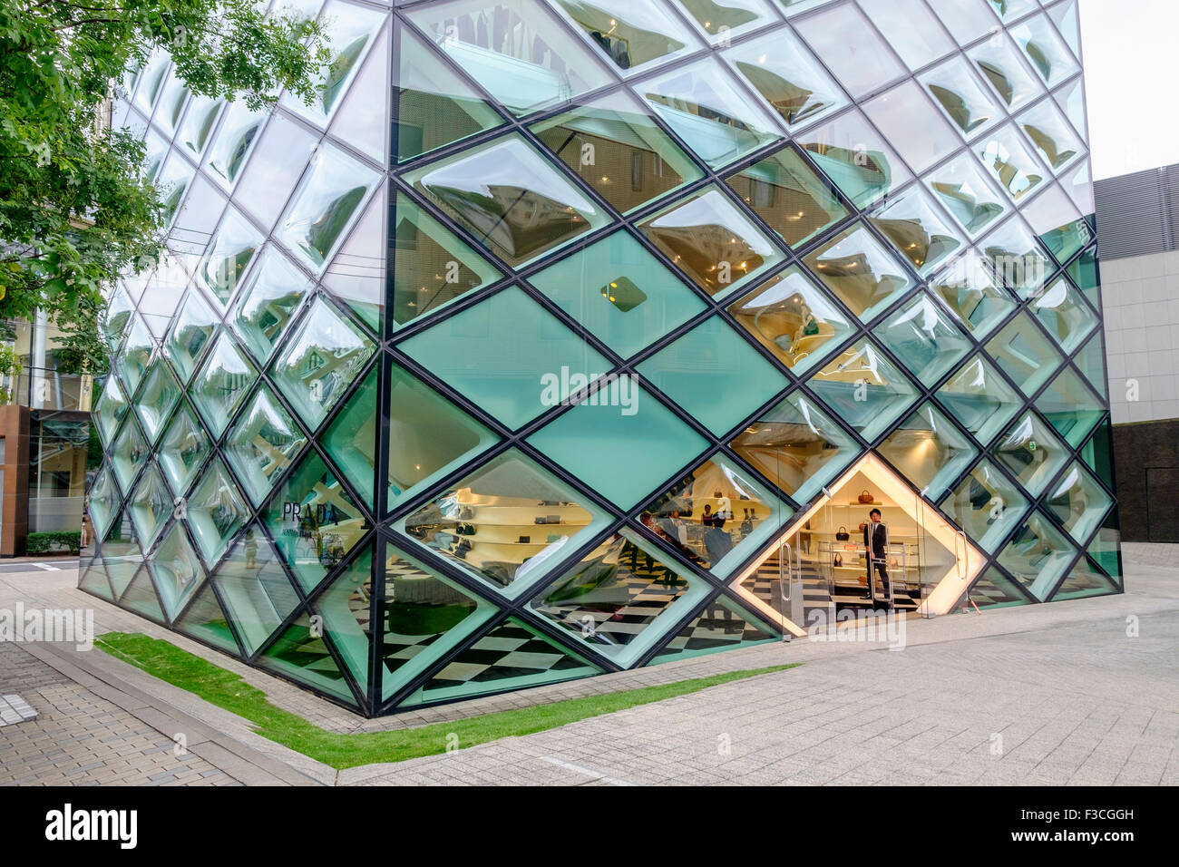Exterior of glass walled Prada flagship store in Aoyama Tokyo Japan - Stock Image