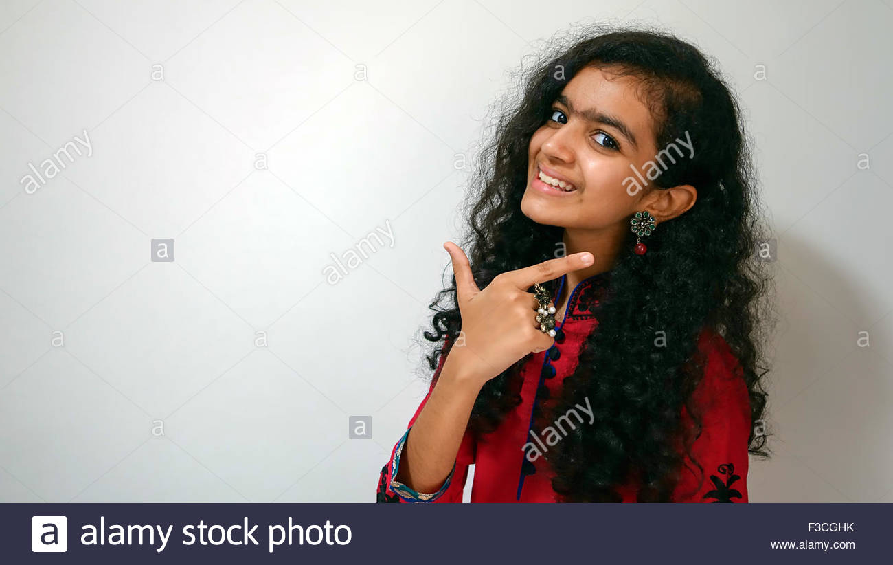 6be6260770 An Indian girl in red, black and blue dress with traditional design ...