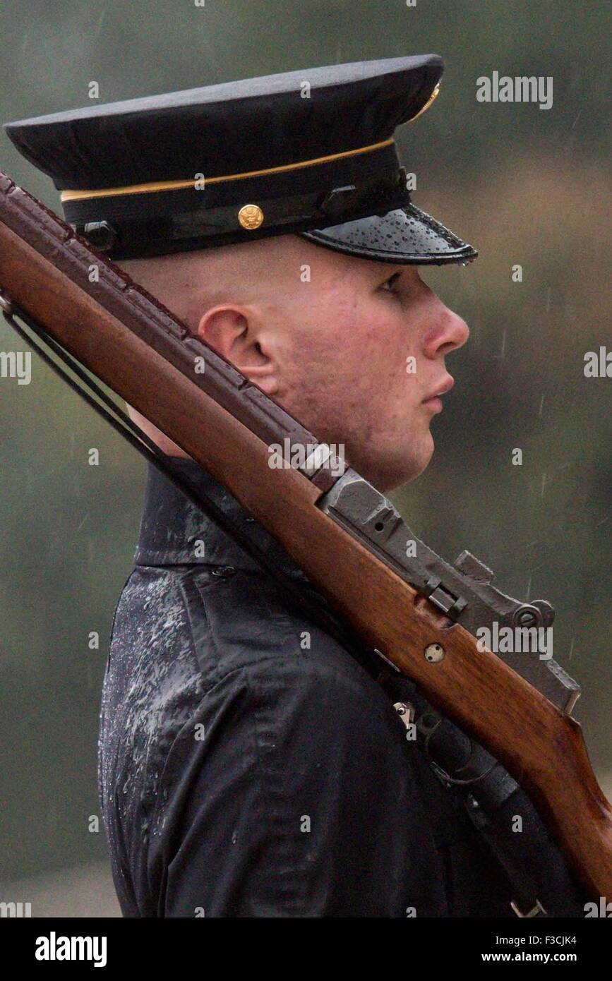 A U.S. Army Tomb Sentinel of the 3rd U.S. Infantry Regiment stands vigil in rain at the Tomb of the Unknowns in - Stock Image