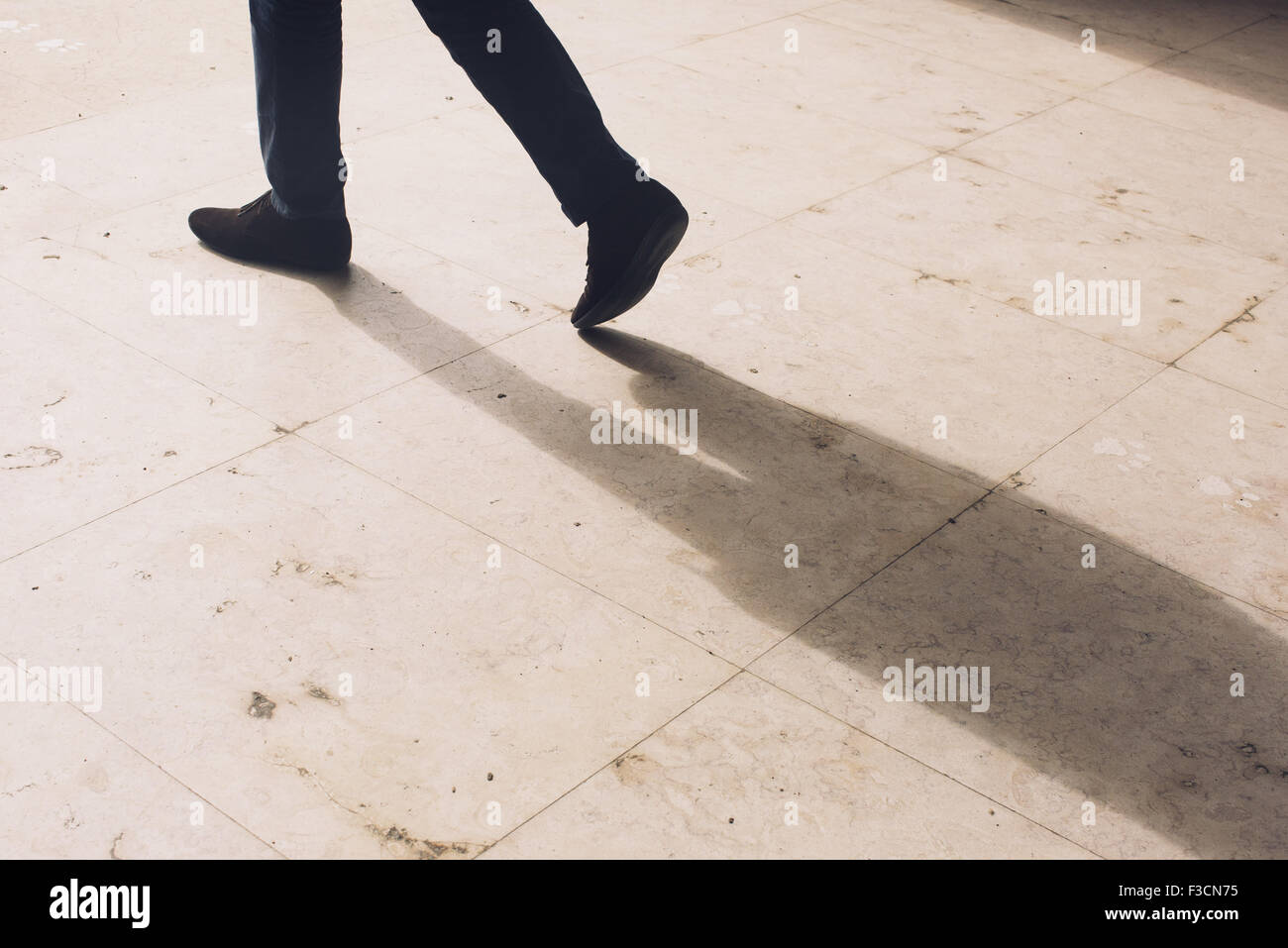 Pedestrian on the move - Stock Image