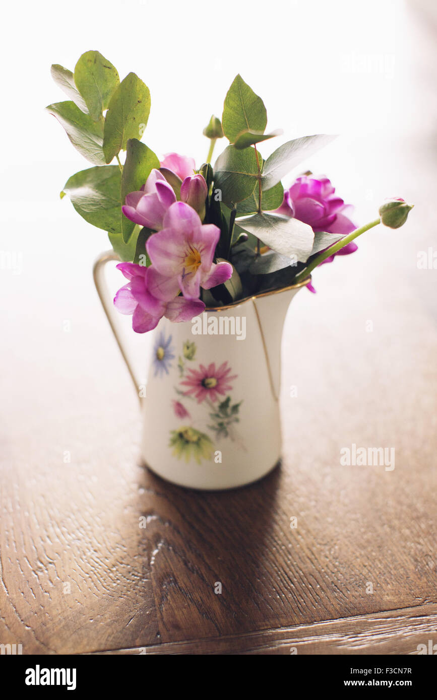 Fresh cut flowers in vase Stock Photo