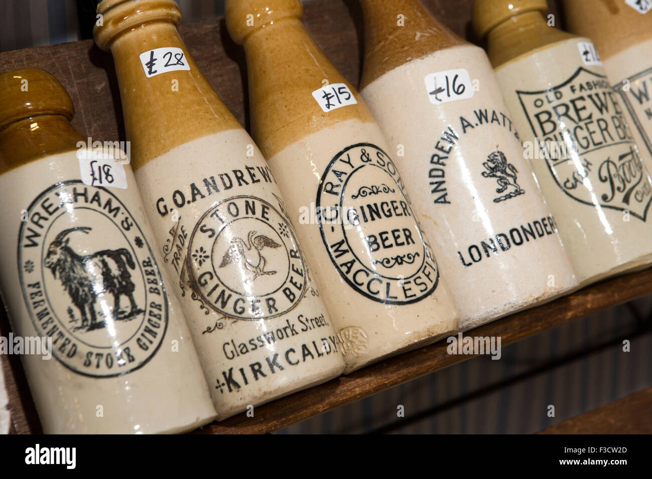UK, England, Lincolnshire, Lincoln, Antiques Fair Indoor Hall, old stoneware ginger beer bottles - Stock Image