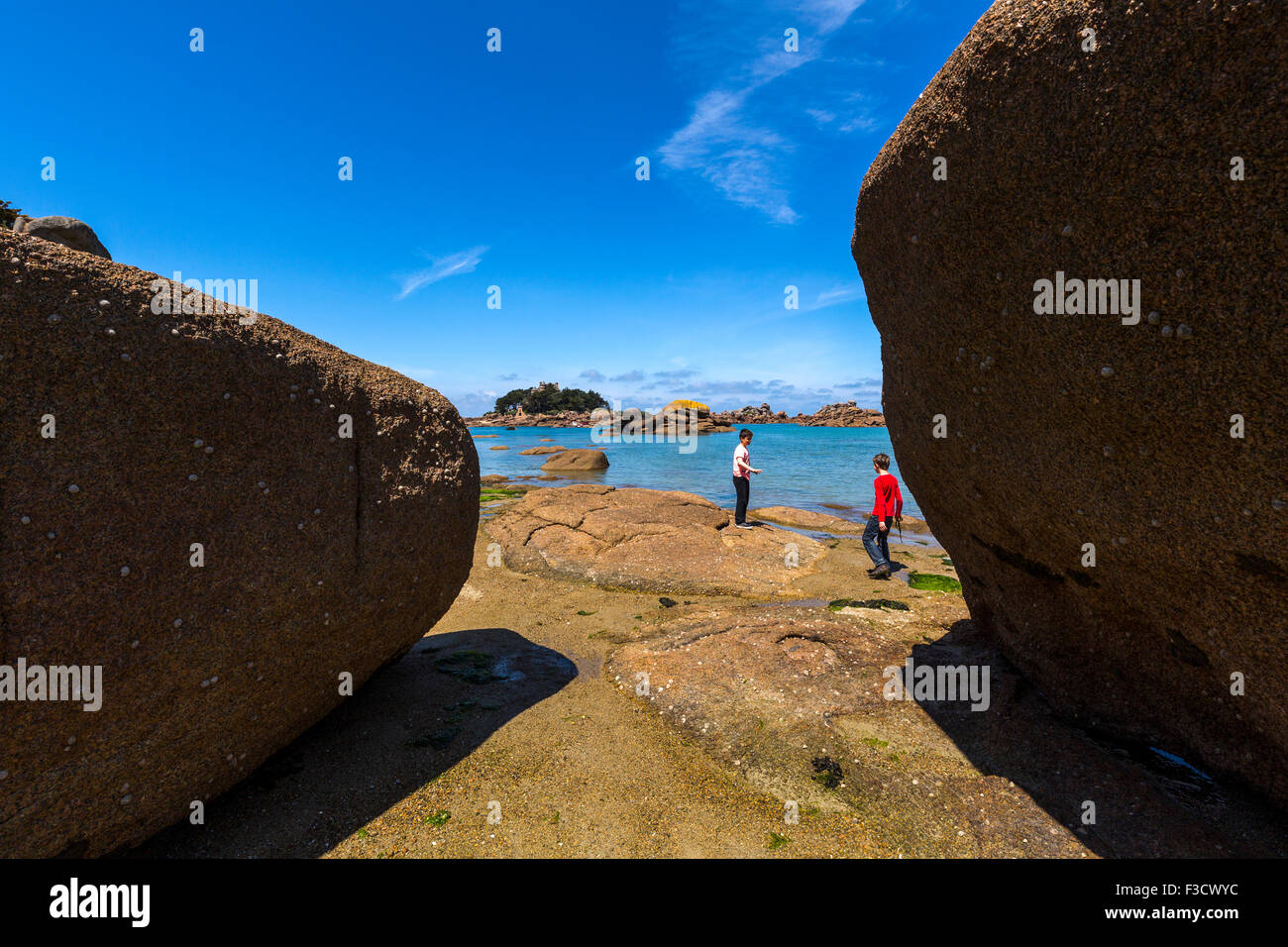 Giant rocks at the Cote granit rose pink granite coast Ploumanac´h Perros Guirec French Brittany France Europe - Stock Image