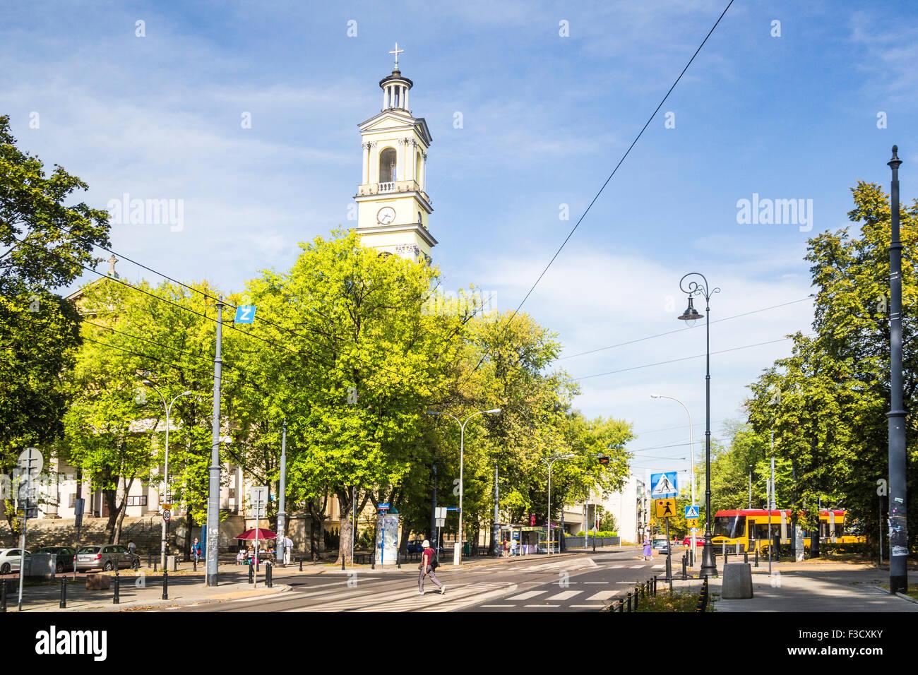 Poland Praga district neighbourhood Warsaw tree-lined wide street and church - Stock Image
