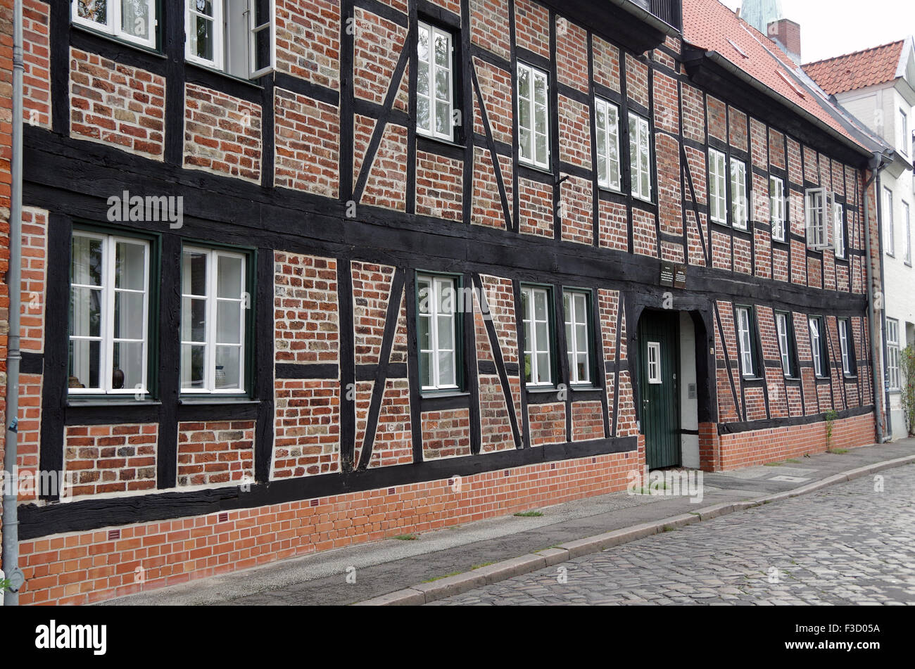 Lubeck Germany, houses and cottages facing R Trave - Stock Image