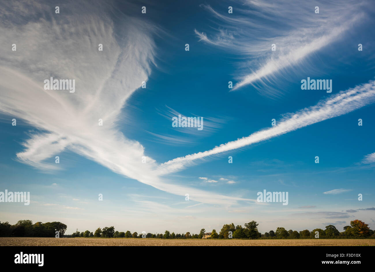 Spectacular cloud formations caused by unusual atmospheric conditions  over the English fenlands near Thorney, Cambridgeshire, - Stock Image
