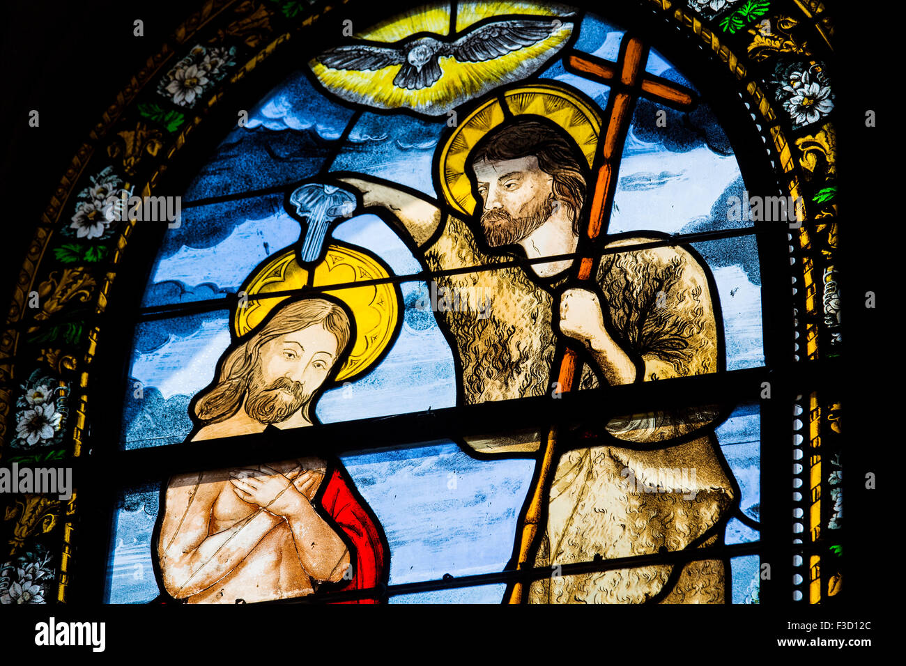 Stained glass window baptism of christ parish church Notre-Dame Saint-Thegonnec Way of St James Finistere French - Stock Image