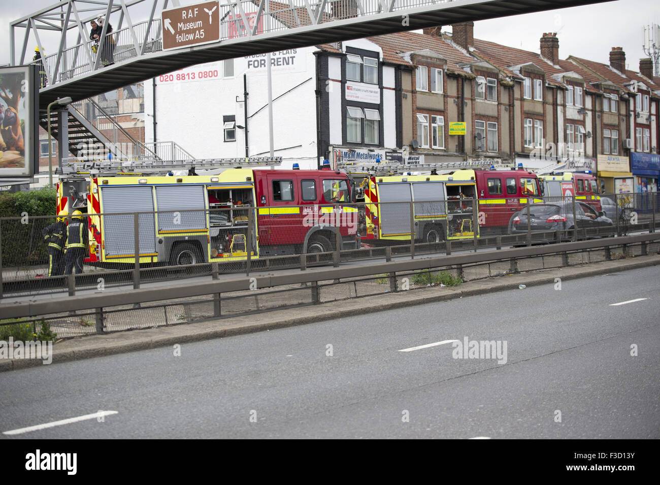Brent reservoir fire brings North Circular to near stand still whilst fire fighters deal with the situation  Featuring: - Stock Image