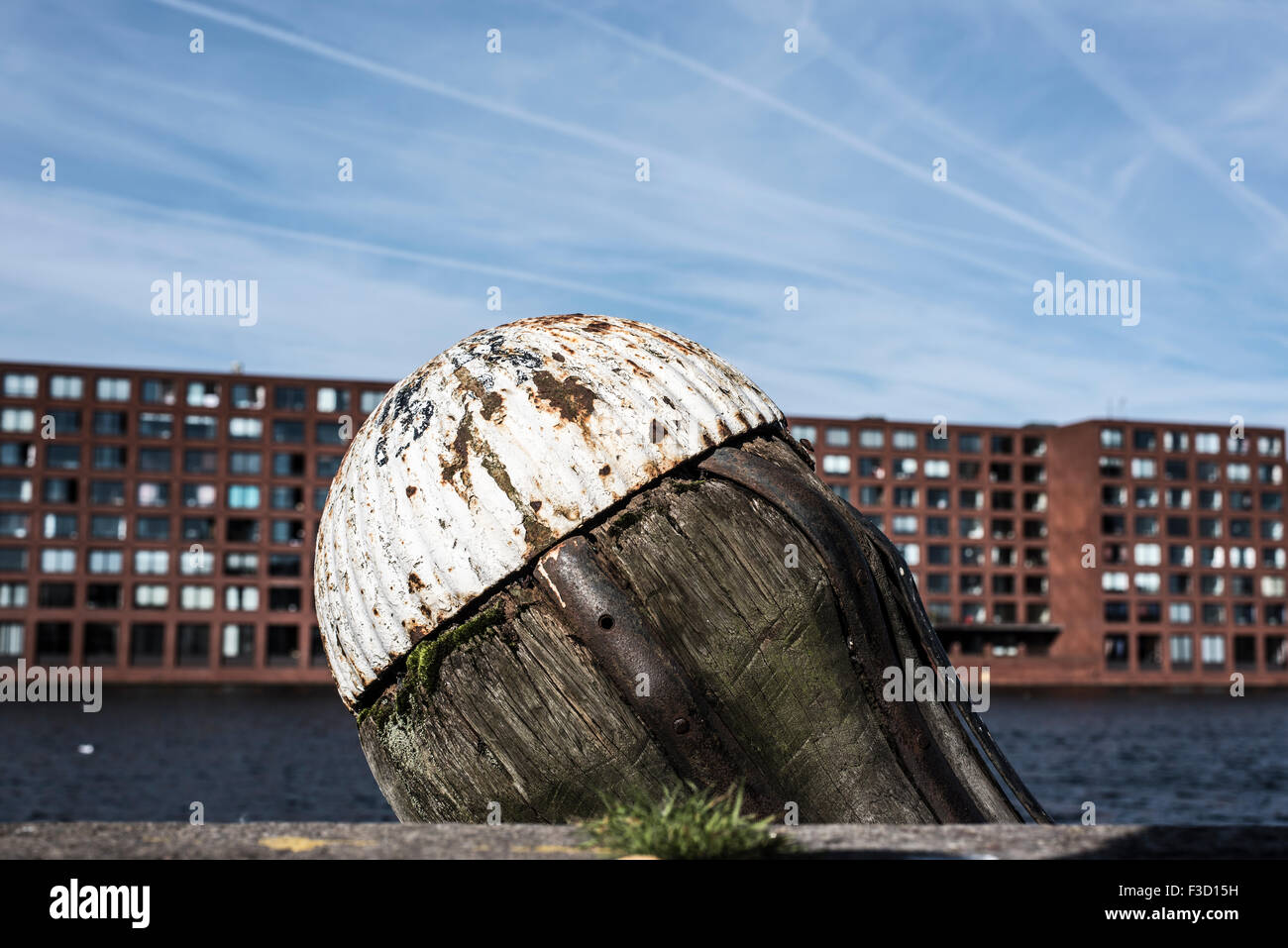 Broken boulder in Amsterdam Harbor, with Java Eiland in the background - Stock Image
