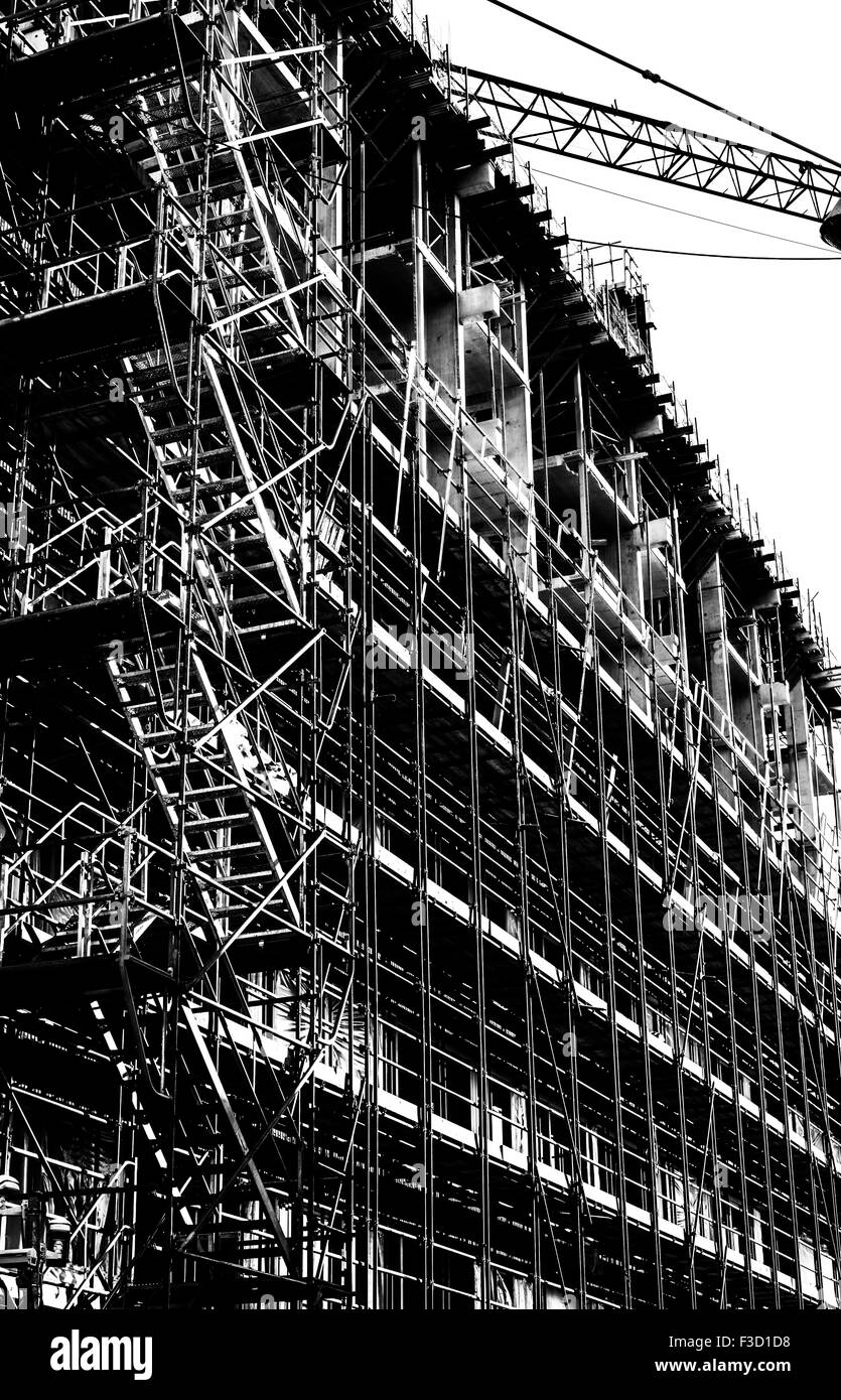 Structured and arty  BW photo of Scaffolding and part of crane boom - Stock Image