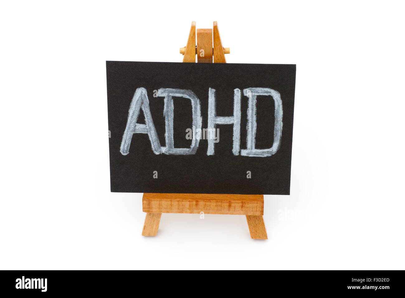Wooden easel with blackboard with letters ADHD isolated on white background - Stock Image