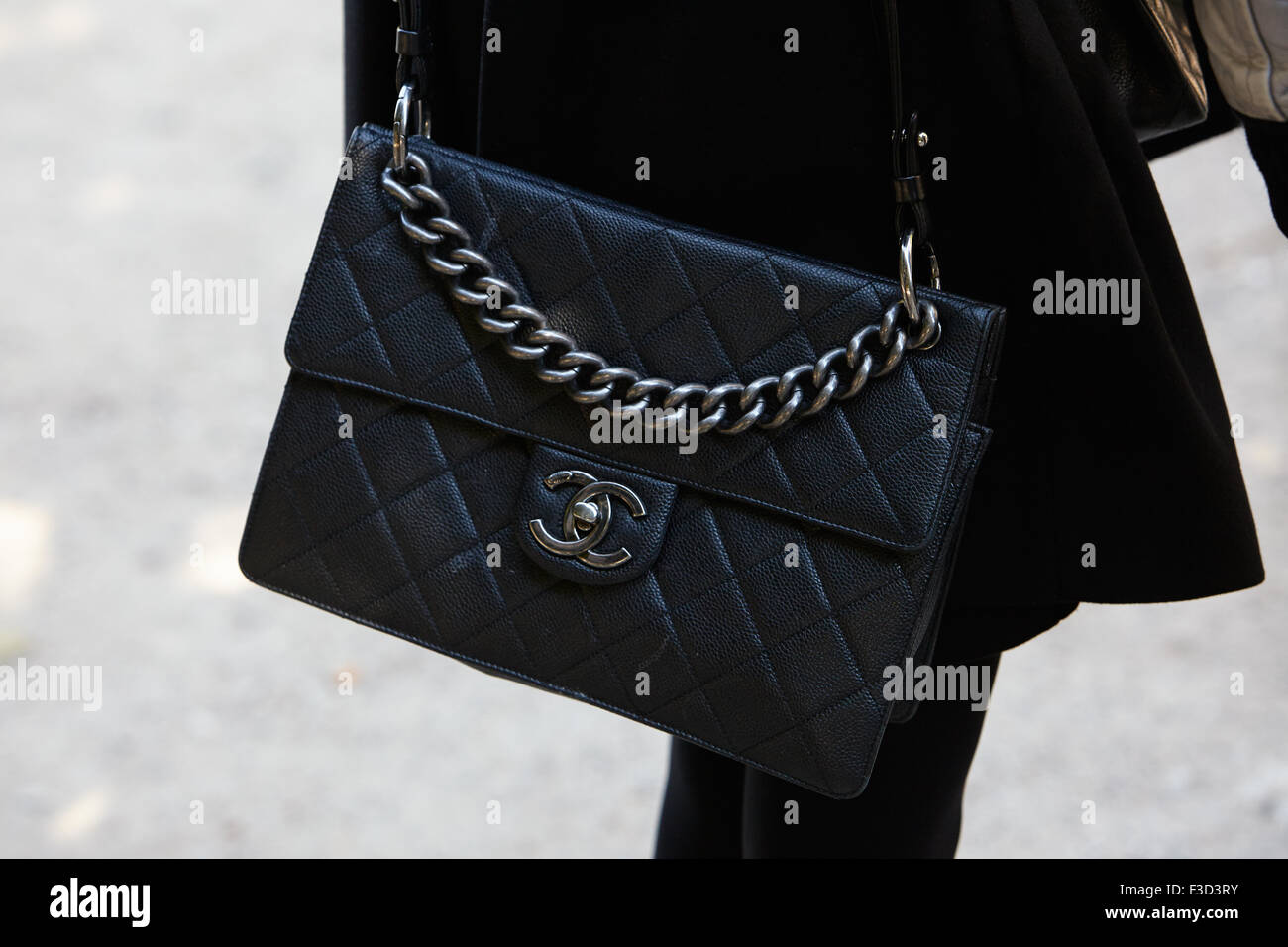 5c904e1e5b37 PARIS - SEPTEMBER 30: Black leather Chanel bag before Yang Li show, Paris  Fashion