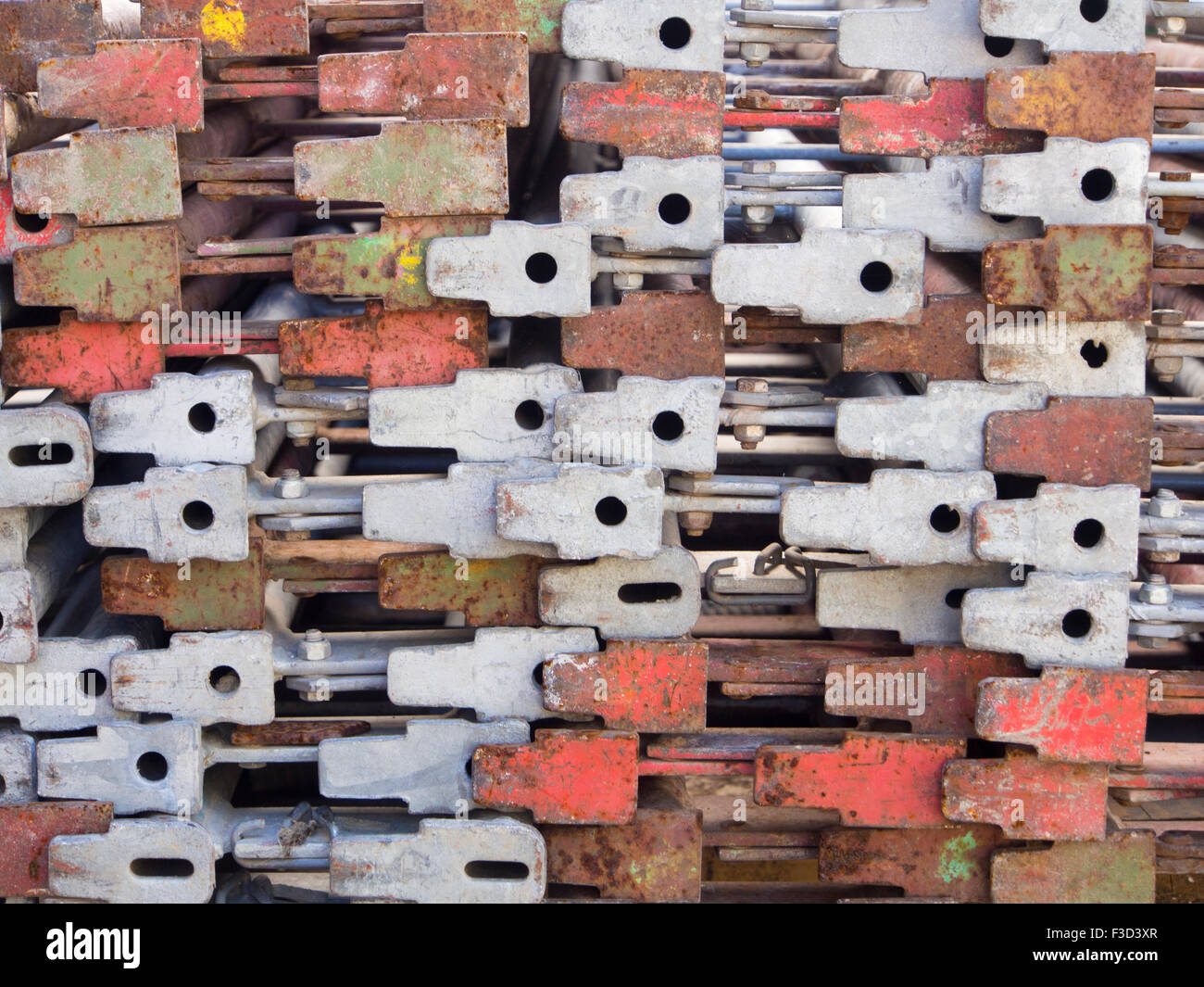 close up of ends of steel scaffolding stacked makes an interesting and irregular pattern - Stock Image