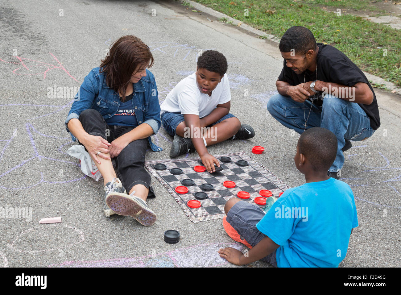 Detroit, Michigan - Members of the Three Mile Block Club play checkers in a blocked-off street during a neighborhood Stock Photo