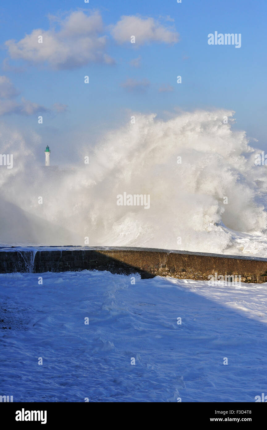 Giant wave crashing over jetty during storm along the North Sea coast - Stock Image
