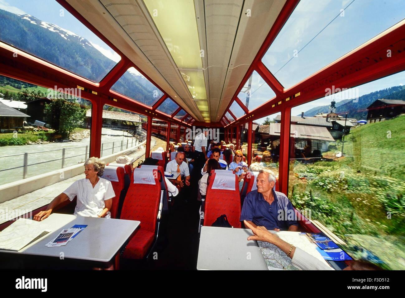 Passengers on board the Glacier Express. Switzerland. Europe - Stock Image
