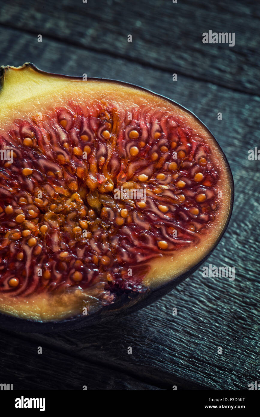 A fig cut in half - Stock Image
