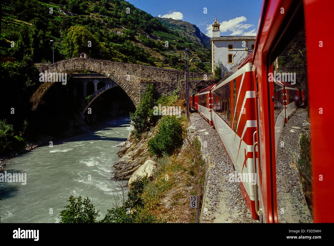 Glacier express railway passing Ritibrücke in Neubrück (Stalden), Switzerland. - Stock Image