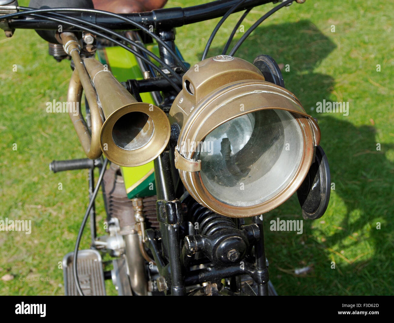 Brass Horn And Acetylene Headlamp (carbide Lamp) On A 1920 Motorcycle  Showing The Primitive